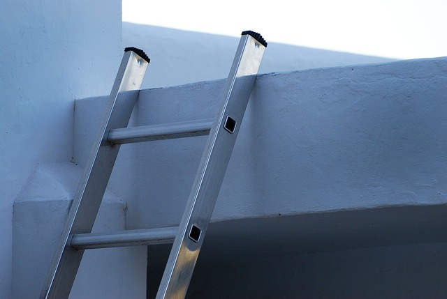 Ladder leaning up against the outside of a house