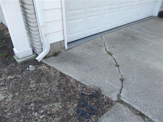 Tips for post winter driveway repair or replacement driveway showing uneven surface and cracks solutioingenieria Image collections