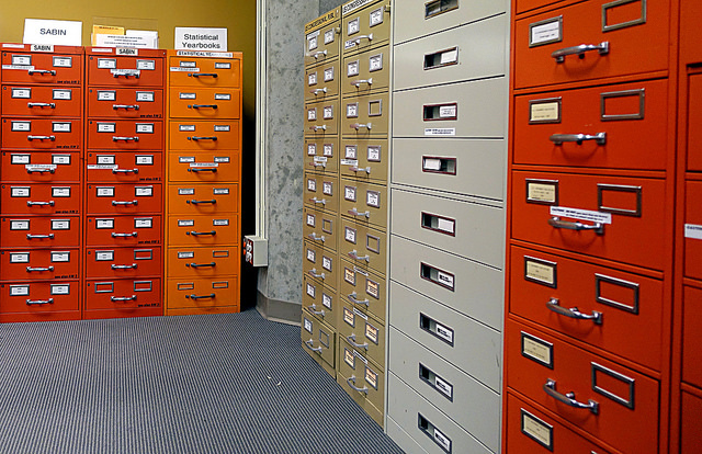Rows of multi-colored filing cabinets