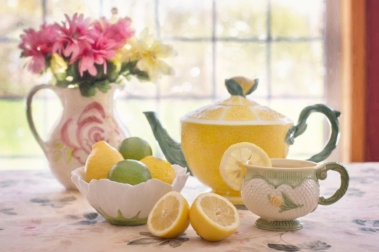 Tea pot with bowl of lemons and limes