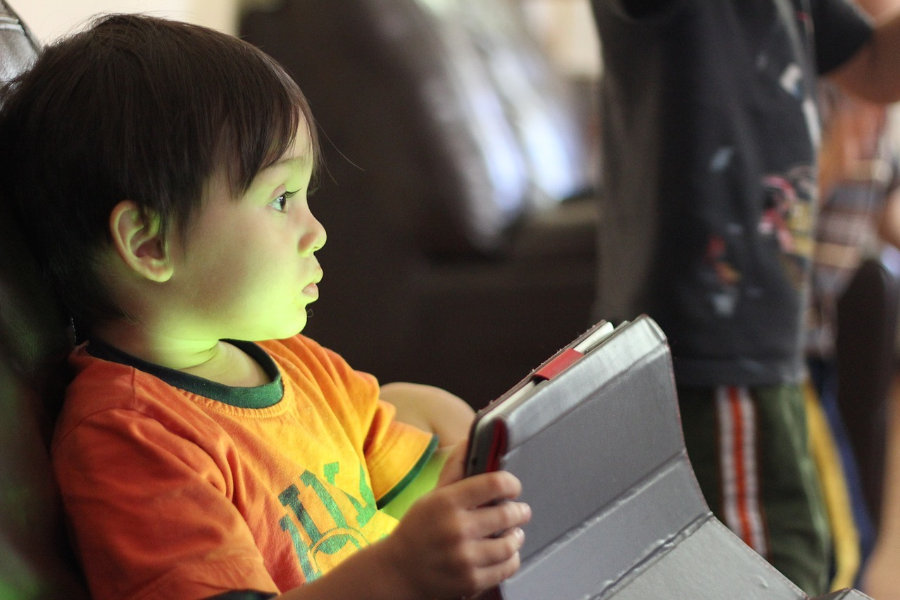 Child with a tablet.