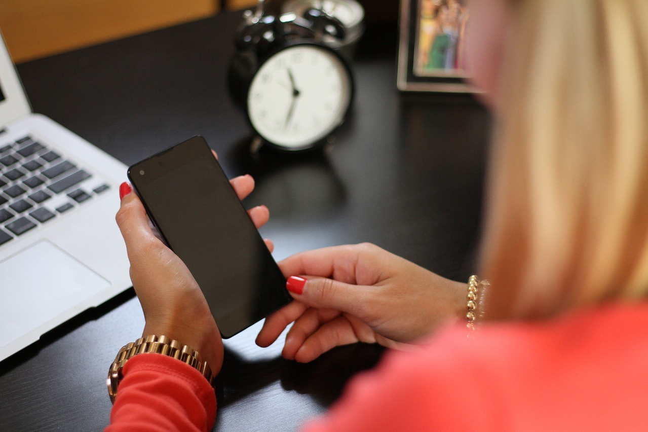 Woman looking at her smart phone
